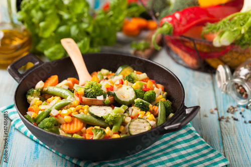 Mix of vegetables fried in a wok. Poster