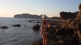 Tourist admires Crete landscape