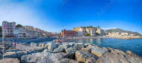 GENOA, (GENOVA), APRIL 29, 2017 - Panoramic view of Vernazzola Beach, colorful houses village in Genoa, Italy