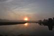 Reflections of the Sunshine Burning through the Fog at Sunrise