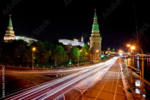 Poster Moscow Kremlin at night. Embankment with car traffic view