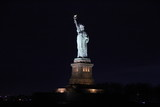 Statue of Liberty shining in the night - 147734242