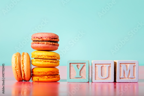 Stack of macarons on pastel background Poster