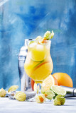 Alcoholic cocktail summer breeze with syrup, lime, orange, beer and ice, selective focus - 147854001