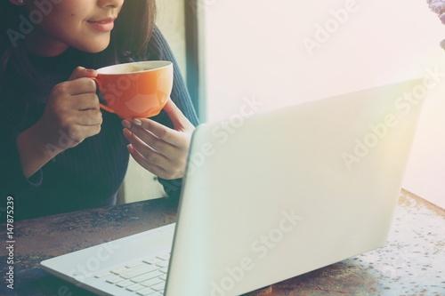 Asian woman working in coffee shop