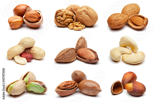 Collection of various nuts on white. плакат