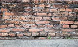 old brick wall and cement floor