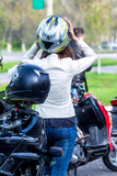 Girl in motorcycle helmet on motorcycle - Girl biker in a leather jacket