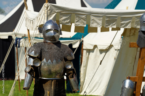 Medieval Festival with exhibited knight armor Poster