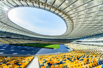 rows of yellow and blue stadium seats on soccer field stadium