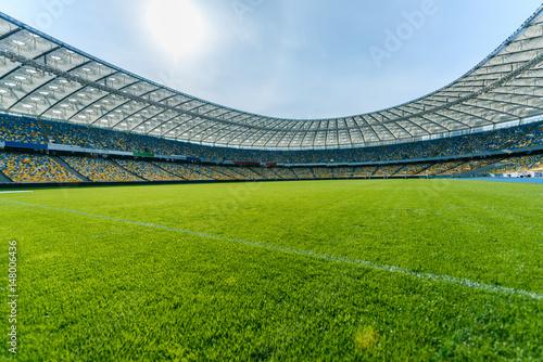 Leinwanddruck Bild Panoramic view of soccer field stadium and stadium seats