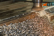 Milling head with metal shavings, Industrial metalworking cutting process by milling cutter machine.