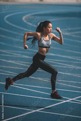 asian sportswoman training on running track stadium, young girl running concept © LIGHTFIELD STUDIOS