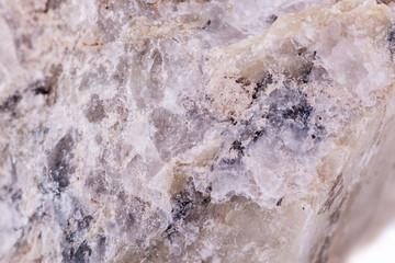 Macro minerals spodumene stone on a white background