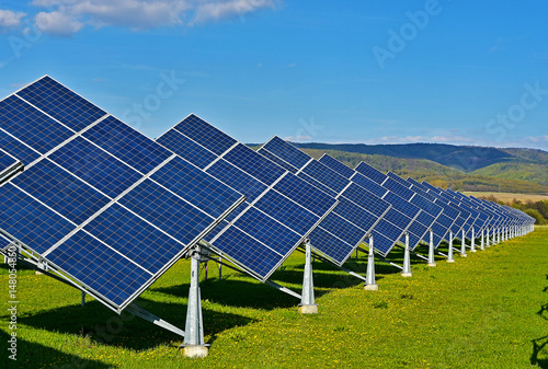 Green energy - photovoltaic power plant on green meadow