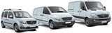 Fototapety Three light commercial vehicles