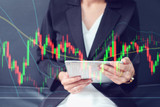 close up double exposure business woman hand holding smart tablet with stock graph and chart background:currency exchange market concept - 148064268