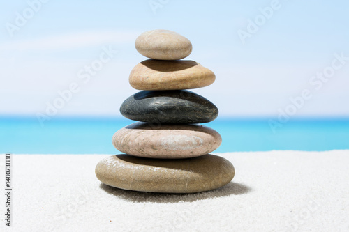 Poster Stenen in het Zand Relaxing in the tropical beach, with white sand and stack of stones