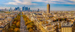 Paris, France - Champs Elysees cityscape. Panorama from the Arc de Triomphe. Blue sky with clouds in autumn. La Defense Financial District in the background.