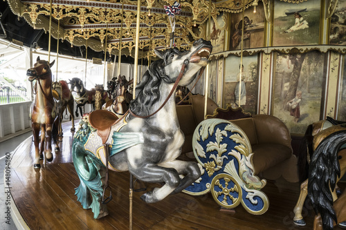 Poster Vintage restored carousel hand carved wooden seahorse on a merry go round ride