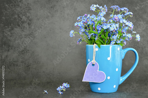 Fathers Day and Mothers Day flowers on dark grunge background