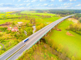Aerial view of bridge over Radbuza River and green pastures. Highway D5 with traffic near Pilsen, Czech republic, Central Europe. Transportation and sustainable development concept. - 148111096