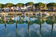Quadro Canal and boats in Grado in bright morning light. North-Eastern Italy, Europe.