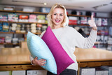 Fototapeta Young female customer boasting purchased home textiles