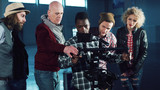 African young man testing handheld camera gyro stabilizin gimbal, the director shows a difference between the mechanical and electronic three-axial video stabilizer - 148127482