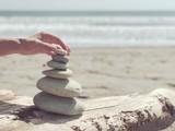 Stack of zen stones on the sea beach.