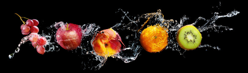 Set of fresh fruits in water splash isolated on black background © Vitaliy