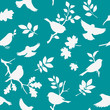 Seamless pattern with bird and twig silhouettes. Spring background with birds and leaves. Vector illustration