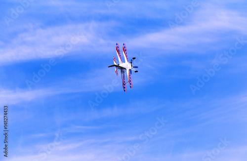 Flight of a sport aircraft against a blue sky.