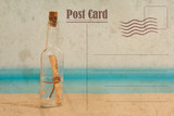 Vintage summer postcard. Message in the bottle on the beach - 148290078