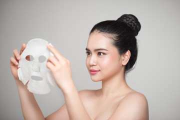 Spa, healthcare. Asian girl with a cosmetic mask.
