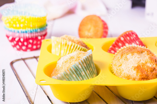 Muffins in silicon form in baking pan Poster