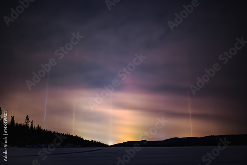 Fotobehang Aubergine Light pillar hallo effect in atmosphere at night