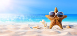 Starfish With Sunglasses On The Sunny Beach - 148403837