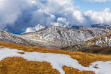 Patches of snow building up on slopes of Snowy Mountains at Mount Kosciuszko National Park, Australia - 148412009