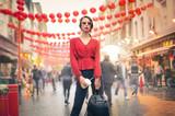 Stylish girl walking in the street - 148422269