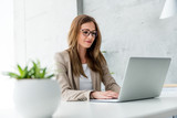 Beautiful Businesswoman typing on laptop - 148435018