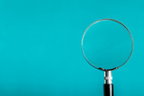 Magnifying glass on blue color background. - 148453872