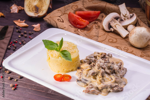 Foto Murales Beef Stroganoff. Juicy veal, stewed with mushrooms and onions in gentle creamy sauce