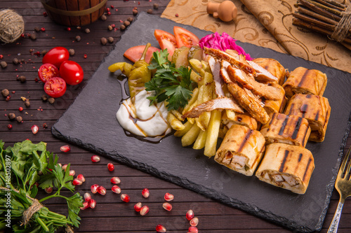 Foto Murales Traditional Arab shawarma with stuffing of the chicken fillet fried on coals, pickles and garlick sauce