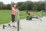 Women working out in park