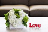Hydrangea flower arrangement with love sign.