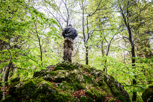 man observes the forest in the spring - outdoor activity and spring season Poster