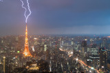 Lightning storm over Tokyo city, Japan in night with thunderbolt over Tokyo tower. Thunderstorm in Tokyo, Japan.