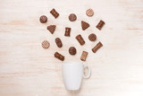 Glass of chocolate milk and variety chocolates on table