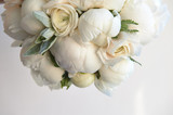 Fototapety Wedding bouquet of white peonies and ranunculuses.Wedding floristry